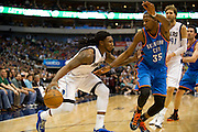 Jae Crowder (9) of the Dallas Mavericks drives on Kevin Durant (35) of the Oklahoma City Thunder at the American Airlines Center in Dallas on Sunday, March 17, 2013. (Cooper Neill/The Dallas Morning News)