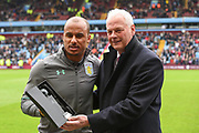 Aston Villa's Gabriel Agbonlahor is presented with an award by Villa's U23 team manager, Kevin MacDonald in recognition of his final game for Aston Villa after 12 years and nearly 400 appearances since joining Aston Villa in 2006 during the EFL Sky Bet Championship match between Aston Villa and Derby County at Villa Park, Birmingham, England on 28 April 2018. Picture by Jon Hobley.