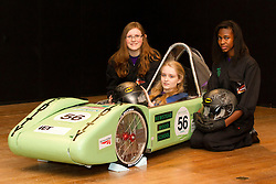 © Licensed to London News Pictures. 08/03/2013. London, UK. The Viridity Racing Team, consisting of Alexa Hancocks (L), Charlotte Prommel (in car) and Stephanie Onamade (R) all pupils of Newstead Wood School, pose with their electric racing car at a photocall ahead of an event celebrating women in science at the Science Museum in London today (08/03/2013). The event, held as part of a three day festival called 'High Performance' and opening at the Science Museum on Friday the 8th of March, marks the extraordinary woman in science as part of International Women's Day. Photo credit: Matt Cetti-Roberts/LNP