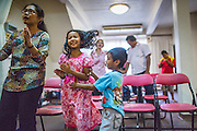 "31 MARCH 2013 - BANGKOK, THAILAND:     ""Nim"" and her family during Easter services at the Thai Peace Foundation office in the Bangkapi section of Bangkok.     PHOTO BY JACK KURTZ"