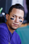 PITTSBURGH, PA - APRIL 25: Carlos Gonzalez #5 of the Colorado Rockies looks on against the Pittsburgh Pirates at PNC Park on April 25, 2012 in Pittsburgh, Pennsylvania. The Pirates won 5-1 in the second game of a doubleheader. (Photo by Joe Robbins) *** Local Caption *** Carlos Gonzalez