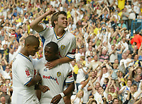Photo: Aidan Ellis.<br /> Leeds United v Hartlepool United. Coca Cola League 1. 08/09/2007.<br /> Leeds Jonny Howson jumps on 1st goal scorer Tresor Kandal's back and Jermain beckford joins in the celebrations