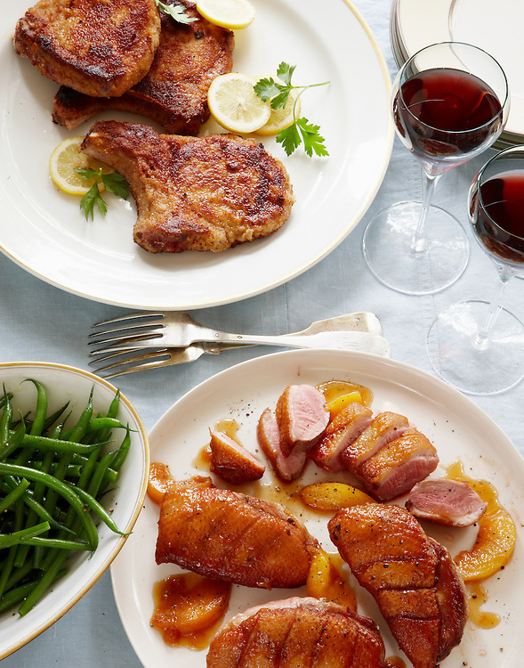 Peach-Glazed Duck Breast and Fried Pork Chop.  Around the Southern Table Cookbook by Rebecca Lang