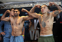 Amir Khan (left) and Samuel Vargas during the weigh in at Arena Birmingham.