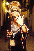 Man in patterned robe, novelty hat and ring, Ibiza, 1999.