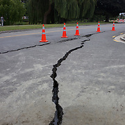 A crack in the road near the Christchurch City Centre. A powerful earth quake ripped through Christchurch, New Zealand on Tuesday lunch time killing at least 65 people as it brought down buildings, buckled roads and damaged houses, churches and the Cities Cathedral. 23rd February 2011.  Photo Tim Clayton