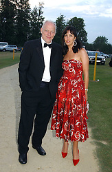 Musician DAVID GILMOUR and his wife POLLY SAMPSON at the Cowdray Gold Cup Golden Jubilee Ball held at Cowdray Park Polo Club, on 21st July 2006.<br /><br />NON EXCLUSIVE - WORLD RIGHTS