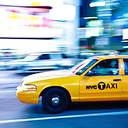 Yellow cab in Time Square by night.
