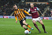 Hull City forward Jarrod Bowen (20) is closely watched by Aston Villa defender Alan Hutton (21)  during the EFL Sky Bet Championship match between Hull City and Aston Villa at the KCOM Stadium, Kingston upon Hull, England on 31 March 2018. Picture by Mick Atkins.