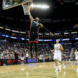 Oct 23, 2013; New Orleans, LA, USA; Miami Heat shooting guard Dwyane Wade (3) dunks against the New Orleans Pelicans during the second half of a preseason game at New Orleans Arena. The Heat defeated the Pelicans 108-95. Mandatory Credit: Derick E. Hingle-USA TODAY Sports