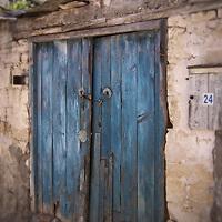 Old blue wooden door to building