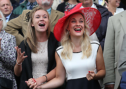 Racegoers Nicola Duffell and Lesley Norton cheer on a winner on the opening day of Glorious Goodwood in the UK, Tuesday, 30th July 2013 <br /> Picture by Stephen Lock / i-Images