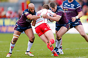 Leeds Rhinos second row Jamie Jones-Buchanan (11) and Leeds Rhinos second row Stevie Ward (13) stop Hull Kingston Rovers winger Ryan Shaw (5)  during the Betfred Super League match between Hull Kingston Rovers and Leeds Rhinos at the Lightstream Stadium, Hull, United Kingdom on 29 April 2018. Picture by Simon Davies.