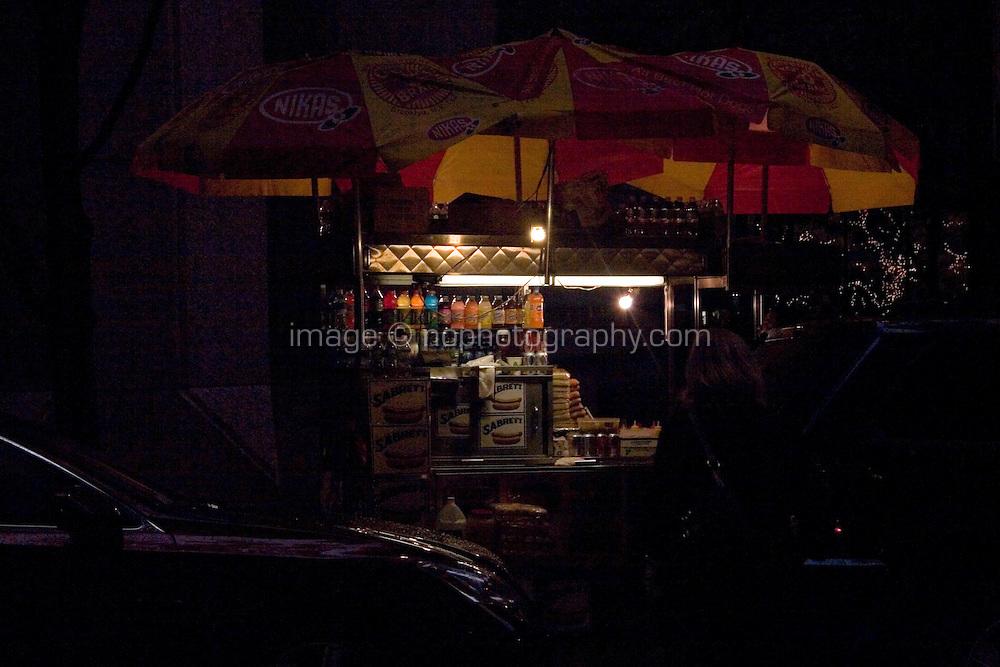 Hotdog stand after dark Midtown Manhattan New York