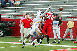 10 September 2011: A pass drops in to the hand of Marcus Harris after clearing defender Dexter Geohagan during an NCAA football game between the Morehead State Eagles and the Illinois State Redbirds at Hancock Stadium in Normal Illinois.