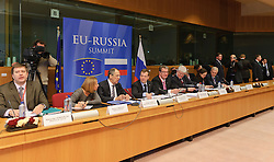 "Dmitry Medvedev, Russia's president, center, confers with members of his delegation, before the start of the EU-Russia summit at the European Union council headquarters in Brussels, Belgium, on Tuesday, Dec. 7, 2010. Russia will move a step closer to membership in the World Trade Organisation today when it signs an agreement with the European Union settling ""key questions"" that have hampered its accession bid for years. (Photo © Jock Fistick).."