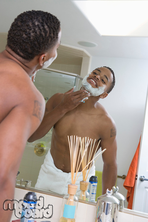 Man Shaving in Mirror