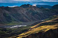 Sunrise at Landmannalaugar, Fjallabak Nature Reserve, Iceland. View from Mount Bláhnúkur looking east towards Brandsgil and Mount Barmur. Sólarupprás í Landmannalaugum. Útsýni frá Bláhnúk til austur yfir Brandsgil og til Barms.