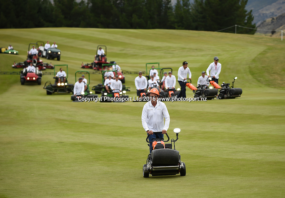 Sir Michael Hill leads his team of groundsmen up the 18th green for the presentations at The Hills during 2016 BMW ISPS Handa New Zealand Open. Sunday 13 March 2016. Arrowtown, New Zealand. Copyright photo: Andrew Cornaga / www.photosport.nz