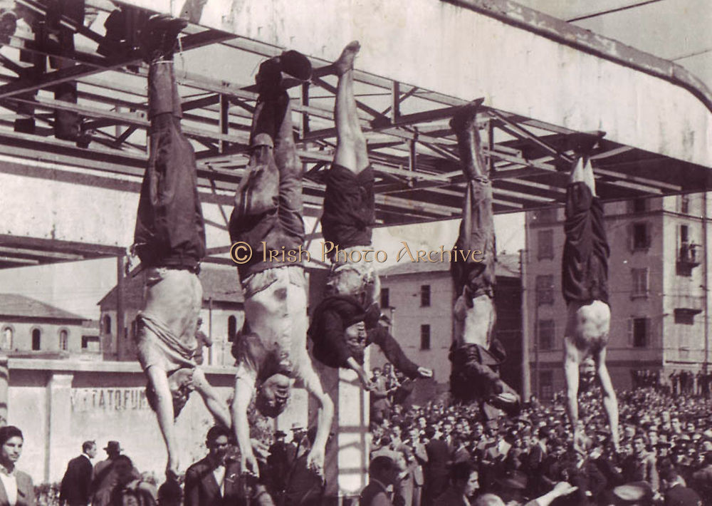 Benito Mussolini (1883-1945) and his mistress  Clara Petacci hanging in a public square after their execution by Italian Communist partisans in April 1945.