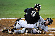 May 18, 2012: UCF catcher Ryan Breen (9) looses the ball as a Rice player slides home to score during C-USA NCAA baseball game 2 action between the Rice Owls and the Central Florida Knights. Rice tied the series by defeating UCF 9-2 in game 2 of the 3 series at Jay Bergman Field in Orlando, FL