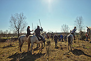 The horsemen, and audience, gather for a morning meal at the pastures where the bulls roam, before the start of the Encerro
