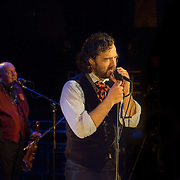 """Group leader John Andrea Comeau aka """"Vaud Overstreet"""" performing with Vaud and the Villains at The Music Hall in Portsmouth, NH. July 2012."""