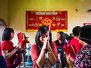 "07 FEBRUARY 2016 - BANGKOK, THAILAND: People pray during Chinese New Year ceremonies at Wat Mangon Kamlawat in Bangkok. Chinese New Year, also called Lunar New Year or Tet (in Vietnamese communities) starts Monday February 8. The coming year will be the ""Year of the Monkey."" Thailand has the largest overseas Chinese population in the world; about 14 percent of Thais are of Chinese ancestry and some Chinese holidays, especially Chinese New Year, are widely celebrated in Thailand.        PHOTO BY JACK KURTZ"