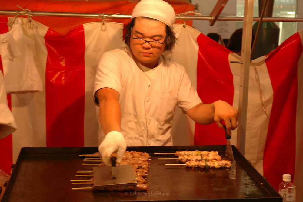 AOMORI, JAPAN - Aomori ken - A cooker prepare some Yaki tori, Chiken skewers, for the Nebuta Matsuri in Aomori - August 2005 ***[FR]*** Yaki Tori (brochette de poulet) Festival Nebuta matsuri dans la ville de Aomori Au nord du Tohoku.