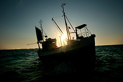 NORWAY LOFOTEN HENNINGSVAER 28MAR07 - Silhouette of a cod-fishing boat off Henningsvaer on the Lofoten islands...jre/Photo by Jiri Rezac..© Jiri Rezac 2007..Contact: +44 (0) 7050 110 417.Mobile: +44 (0) 7801 337 683.Office: +44 (0) 20 8968 9635..Email: jiri@jirirezac.com.Web: www.jirirezac.com..© All images Jiri Rezac 2007 - All rights reserved.