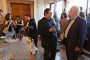 Venice, Italy. 14th Architecture Biennale 2014, &quot;fundamentals&quot;.<br /> Cocktail at Biennale Office. Biennale President Paolo Baratta (r.)