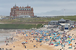 © Licensed to London News Pictures. 31/07/2020. Newquay, UK. People enjoy the hot weather on Fistral Beach, Cornwall, on a very hot day in the southwest. Parts of the country are expected to have the hottest day of the year so far. Photo credit : Tom Nicholson/LNP