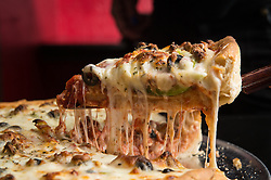 Chicago-style deep dish pizza at Gelazzi in the Heights. (Editorial: Houstonia Magazine)
