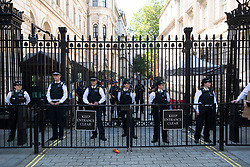 © Licensed to London News Pictures. 31/05/2020. London, UK. Supporters for the group Black Lives Matter demonstrate against police officers in Whitehall for the American George Floyd who died whilst being arrested by US policemen Derek Chauvin. Photo credit: London News Pictures.