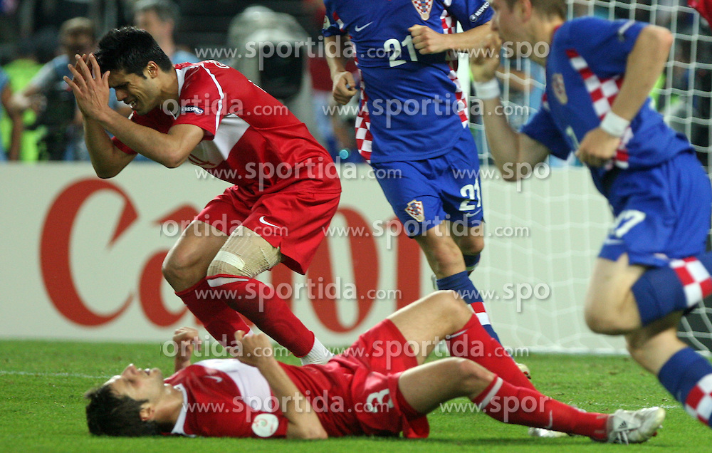 Sad Gokhan Zan and Hakan Balta (lying) after Croatian goal during the UEFA EURO 2008 Quarter-Final soccer match between Croatia and Turkey at Ernst-Happel Stadium, on June 20,2008, in Wien, Austria. Turkey won after penalty shots. (Photo by Vid Ponikvar / Sportal Images)