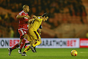 Middlesbrough midfielder Emilio Nsue  tussles with Burnley midfielder Joey Barton  during the Sky Bet Championship match between Middlesbrough and Burnley at the Riverside Stadium, Middlesbrough, England on 15 December 2015. Photo by Simon Davies.