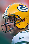 KANSAS CITY, MO - AUGUST 29:  Aaron Rodgers #12 of the Green Bay Packers smiles on the sidelines against the Kansas City Chiefs during the last preseason game at Arrowhead Stadium on August 29, 2013 in Kansas CIty, Missouri.  (Photo by Wesley Hitt/Getty Images) *** Local Caption *** Aaron Rodgers