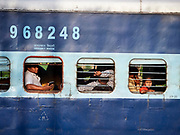 India, Uttar Pradesh. Lucknow. Regular express train seen from aboard Maharajas' Express.