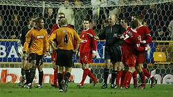 WOLVERHAMPTON, ENGLAND - Wednesday, January 21st, 2004: The referee Barry Knight steps in between Liverpool's Steven Gerrard (r) and Wolverhampton Wanderers' Paul Ince (l) during the Premiership match at Molineux. (Pic by David Rawcliffe/Propaganda)