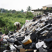 Electronic waste export to Nigeria...Alaba International Market, one of the largest markets for electronic goods in West Africa.  New and old - and a lot of non-working electronic goods such as TVs and computers come in to the market via Lagos harbour from the US, Western Europe and China..A dump site at the back of the market.  The dump is mainly televison casings, some circuit boards and general waste.  The dump is slowly moving into the swampy land, functioning as a land fill...The shipment - TV-set originally delivered to municipality-run collecting point in UK for discarded electronic products - was tracked and monitored by Greenpeace using a combination of GPS (Global Positioning System using satellites), GSM (positioning using data from mobile networks to triangulate approximate positions) and an onboard radiofrequency transmitter (used for making triangulations in combination with handheld directional receivers used by team on ground) is placed inside the TV-set.  The TV arrived in Lagos in container no 4629416.