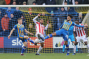 8 Greg Docherty and  20 Aaron Holloway for Shrewsbury Town challenge Stoke City defender Ashley Williams (5) on loan from Everton,during the The FA Cup 3rd round match between Shrewsbury Town and Stoke City at Greenhous Meadow, Shrewsbury, England on 5 January 2019.
