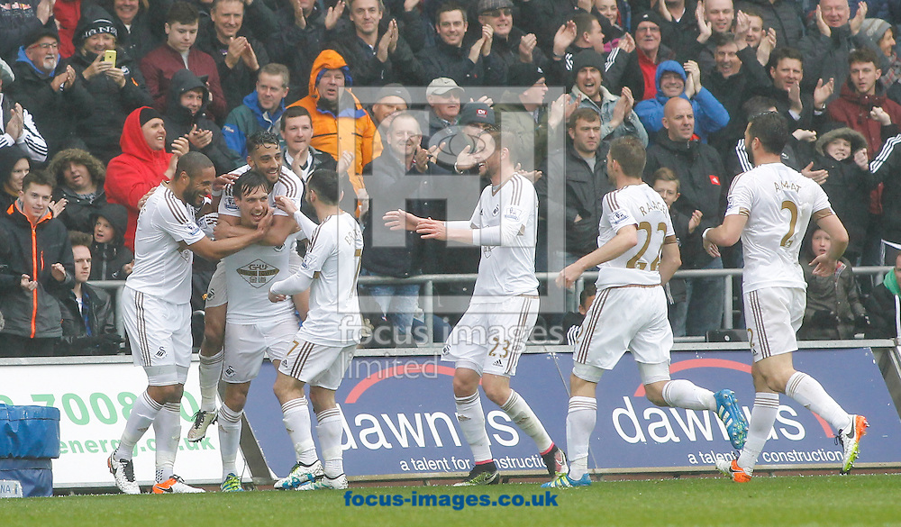 Jack Cork and team mates celebrate the second goal for Swansea City during the Barclays Premier League match at the Liberty Stadium, Swansea, UK.<br /> Picture by Mike Griffiths/Focus Images Ltd +44 7766 223933<br /> 01/05/2016