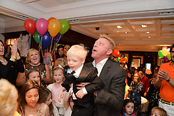 BORIS BECKER and his son AMADEUS BECKER at the 4th birthday party for Amadeus Becker, son of Boris & Lilly Becker held at Ralph Lauren, 143 New Bond Street, London on 9th February 2014.
