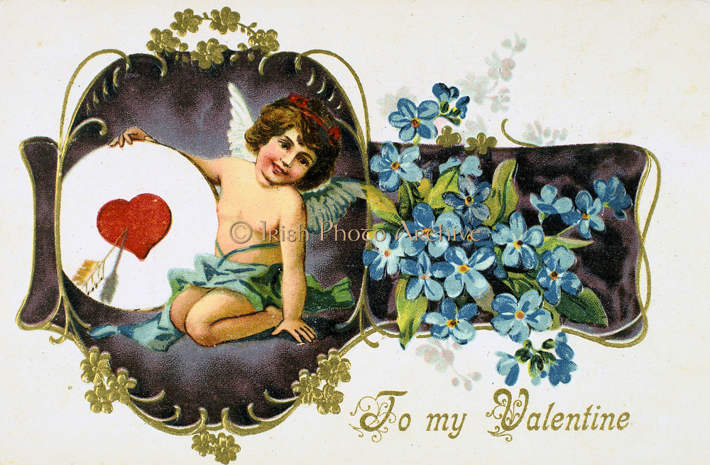 To My Valentine', American Valentine card, 1907.  Cupid holds a heart pierced by an arrow. The flowers are Forget-me-nots (Myosotis palustris).   In Roman mythology Cupid was the son of Venus, goddess of love (Eros and Aphrodite in the Greek Pantheon).  The identity of St Valentine is uncertain, the most popular candidates are Valentine, bishop of Terni (3rd century) or a Roman Christian convert martyred c270).  St Valentine's Day, celebrated on 14 February, probably replaces the Roman pagan festival of Lupercalia.