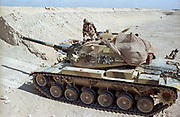An Egyptian soldier positions a M60 battle tank along the sand berm border wall on the frontline separating Kuwait from Saudi Arabia February 8, 1991 in Ar Ruqi, Saudi Arabia.