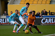 Derby County midfielder George Thorne holds up Wolverhampton Wanderers midfielder Nathan Byrne during the Sky Bet Championship match between Wolverhampton Wanderers and Derby County at Molineux, Wolverhampton, England on 27 February 2016. Photo by Alan Franklin.