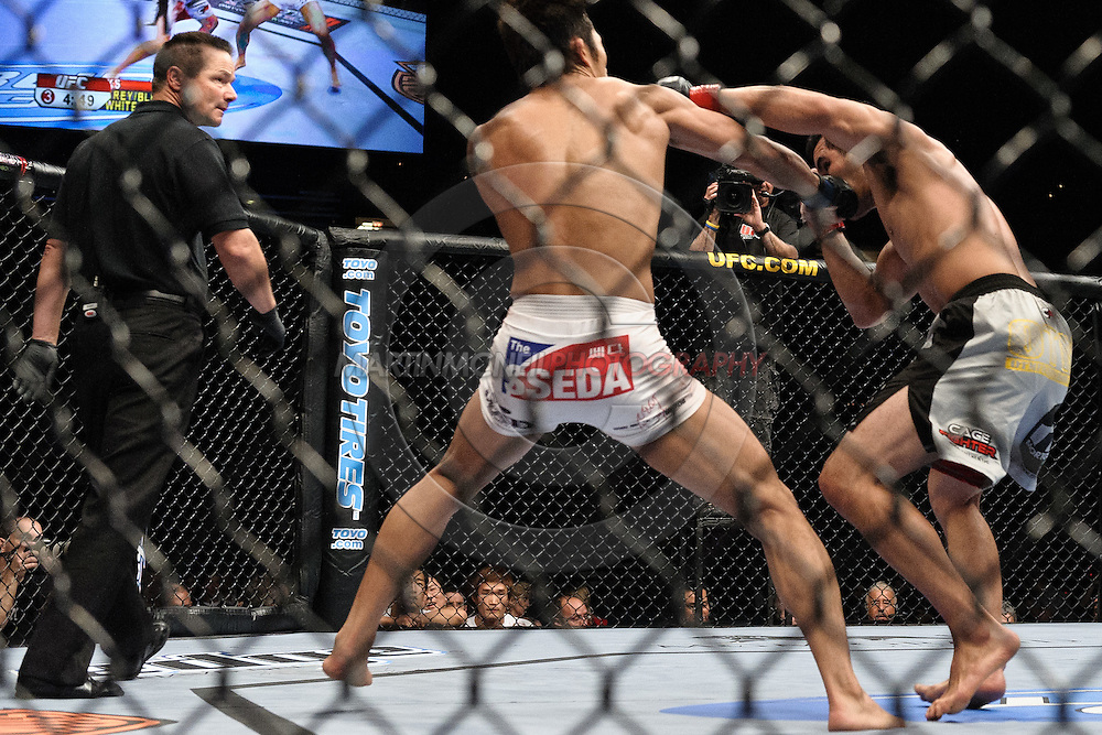 """LAS VEGAS, NEVADA, MAY 24, 2008: Dong Hyun Kim (centre) lands a punch to the jaw of Jason Tan during """"UFC 84: Ill Will"""" inside the MGM Grand Garden Arena in Las Vegas"""