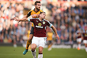 Arsenal defender Shkodran Mustafi (20)  and Burnley forward Sam Vokes (9) challenges for the ball  during the Premier League match between Burnley and Arsenal at Turf Moor, Burnley, England on 2 October 2016. Photo by Simon Davies.