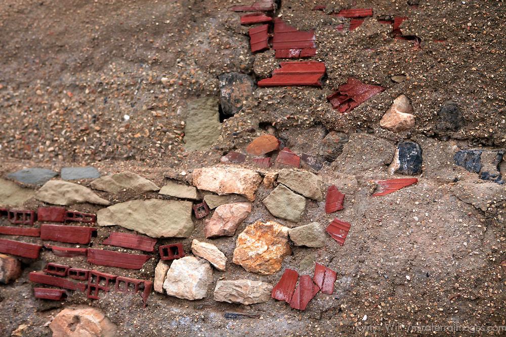 Europe, Spain, Novelda. wall of mixed elements, brick, stone, and dirt.