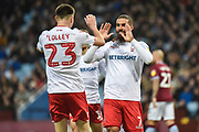 Nottingham Forest forward Lewis Grabban (7) scores a goal and celebrates with team mate Nottingham Forest defender Joe Lolley (23) 0-1 during the EFL Sky Bet Championship match between Aston Villa and Nottingham Forest at Villa Park, Birmingham, England on 28 November 2018.